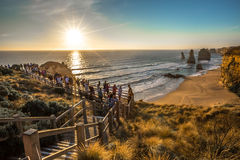 Tourists observe the Twelve Apostles at sunset Stock Image