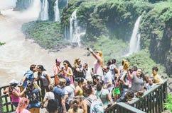 Tourists on the observing deck of the Cataratas do Iguacu. Foz do Iguacu, Brazil - January 07, 2018: Tourists on the observing deck of the Cataratas do Iguacu Stock Image