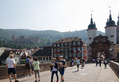 Tourists at an old bridge in the city Heidelberg in Germany Stock Photography