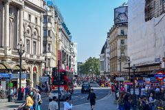Tourists, Old Buildings and Scaffolding in London Street on a Sunny Summer Day stock photos