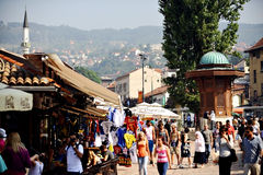 Tourists in old Sarajevo bazaar Royalty Free Stock Photo