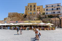 Tourists at old street of Chania town on Crete island. Royalty Free Stock Image