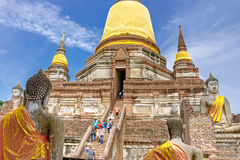 The tourists and Old Temple Architecture, Wat Yai Chai Mongkol at Ayutthaya, Thailand, World Heritage Site Stock Photo