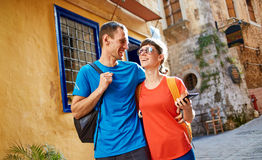 Tourists in the old town. Couple tourists walking in the old town. Couple in love, have Honeymoon on Crete, Greece Stock Image