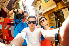 Tourists in the old town. Couple tourists walking in the old town and take selfie Royalty Free Stock Images
