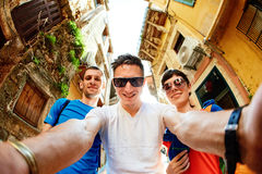 Tourists in the old town. Couple tourists walking in the old town and take selfie Stock Image