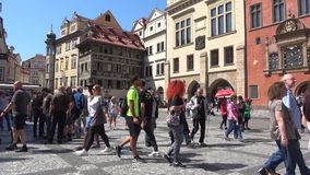 Tourists on the old town square, Sunny day. Prague. PRAGUE, CZECH REPUBLIC - APRIL 21, 2018: Tourists on the old town square on a Sunny day stock video