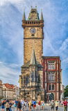 Tourists on Old Town Square. View towards Old Town Clock tower, Stare Mesto, Prague. PRAGUE, CZECH REPUBLIC - AUGUST 9, 2015: Tourists on Old Town Square. View royalty free stock photography