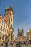 Tourists on Old Town Square. View towards Old Town Clock tower, Stare Mesto, Prague. PRAGUE, CZECH REPUBLIC - AUGUST 3, 2015: Tourists on Old Town Square. View stock image
