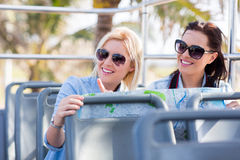 Tourists open top bus Stock Images