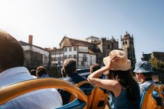 Tourists on open top sightseeing bus in city royalty free stock photo
