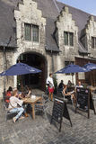 Tourists at outdoor cafe in centre of the medieval town Ghent in Stock Photo