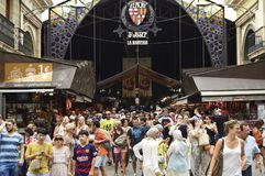 Tourists outside covered marketplace in Barcelona Spain royalty free stock image