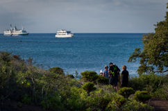 Tourists overlooking cruise ships from an island Royalty Free Stock Photography