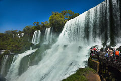 Tourists overlooking The Iguasu Falls. MW - A platform right in the spray crowded with tourists overlooking the Iguasu Falls on the Argentinian side Stock Photos