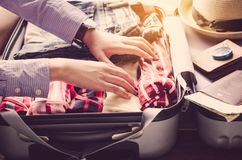 Tourists are packing luggage for travel. Royalty Free Stock Image