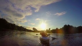 Tourists paddling boat at sunset, teamwork, active rest slowmo. Stock footage stock video footage