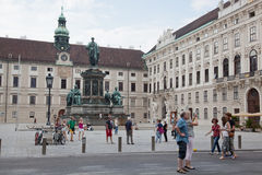 Tourists on Palace of Hofburg in Vienna Stock Images