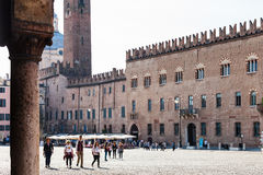 Tourists and Palazzo Bonacolsi Castiglioni. MANTUA, ITALY - MARCH 31, 2017: tourists and Palazzo Bonacolsi Castiglioni on Piazza Sordello in Mantua. The palace Royalty Free Stock Photography