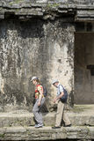 Tourists at Palenque mayan city ruins in Mexico. CHIAPAS, PALENQUE, MEXICO – MARCH 1, 2016: senior tourist couple walk the ruins of Palenque royalty free stock photography