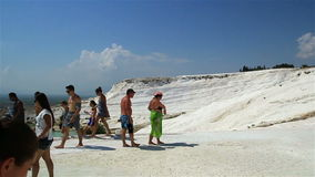 Tourists on Pamukkale Travertine pools and terraces. stock footage