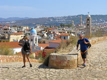 Greece, Crete, Chania town,  tourists. Chania, Crete, Greece. Tourists on high point for sightseeing of town. From there panoramic view of old town, sea and Stock Image