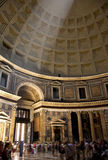 Tourists in the Pantheon. A ray of light streams down through the skylight in the Pantheon over a crowd of tourists Royalty Free Stock Images