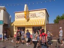Tourists at Paradise Pier, Disney California Adventure Park. ANAHEIM, CALIFORNIA - FEBRUARY 13: Tourists at Paradise Pier  at Disney California Adventure Park on Stock Photo