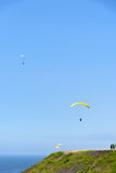 Tourists paragliding in the sky Stock Image