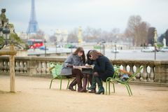 Tourists in Paris planning their trip Stock Photos