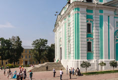 Tourists and parishioners around the bell tower. Holy Trinity-St. Sergiev Posad Royalty Free Stock Photo