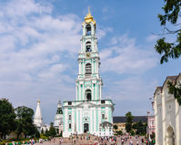 Tourists and parishioners around the bell tower. Holy Trinity-St. Sergiev Posad Royalty Free Stock Image