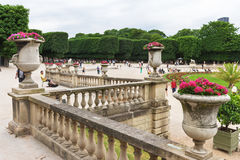 Tourists and parisians relaxing in the Luxembourg Gardens. Paris Stock Photo