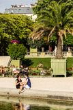 Tourists and Parisians relaxing in the Luxembourg Gardens. Paris. Paris, France - July 07, 2017: Tourists and Parisians relaxing in the Luxembourg Gardens Jardin Royalty Free Stock Images