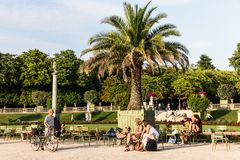 Tourists and Parisians relaxing in the Luxembourg Gardens. Paris. Paris, France - July 07, 2017: Tourists and Parisians relaxing in the Luxembourg Gardens Jardin Royalty Free Stock Photography