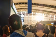 Tourists passenger queuing up travel export in airport. At sunset Royalty Free Stock Photography