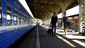 Tourists and passengers with suitcases are on the platform of railway station.  stock video