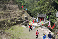 Tourists passing through a small temple of remote mountains Royalty Free Stock Photo