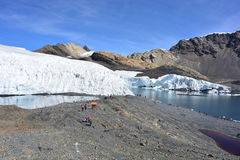 Tourists at the Pastoruri glacier, inside the Huascarán National Park, Peru. The famous Pastoruri glacier, one of the touristical attractions of the Huascarán Stock Photography