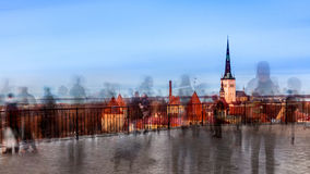 Tourists at Patkuli viewing platform. Tourists are moving fast taking a peek at Old Tallin lower city walls, towers and churches leaving only silhouettes on this Royalty Free Stock Image