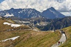 Tourists on the peak of Tatra mountains, Zakopane, Poland Royalty Free Stock Photo