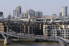 Tourists and people on bridge of Thames river Stock Image