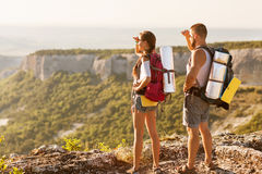 Tourists - people hiking in mountain stock photography
