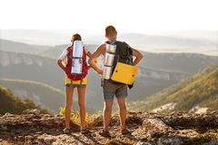 Tourists - people hiking in mountain Stock Images