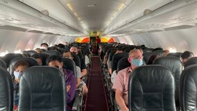 Tourists Peoples in Face Masks in Plane During Coronavirus Pandemic Situation