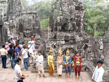 Tourists and performers inside Bayon Temple at Angkor in Cambodia Stock Photography