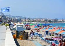 Tourists on Perivolia beach, Crete. Tourists relaxing on the sandy beach, Perivolia, Crete, Greece, Europe Stock Photo