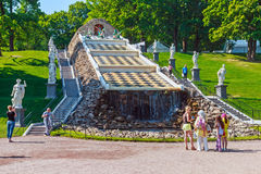 Tourists in Peterhof fountain Cascade Stock Photography