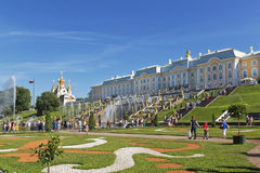 Tourists in Peterhof about fountains of the Grand Cascade Royalty Free Stock Photography