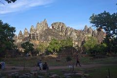Tourists at Phnom Bakheng temple Royalty Free Stock Photos